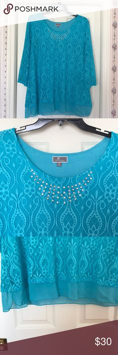 JM Collection Top Stunning top😍 beautiful color. Lace overlay with built in soft T-shirt feel tank underneath. Studs around neck. Slits on each side at hip. Sleeves are lace and see through. Bust measures 24 inches laid flat on my kitchen island. This would be gorgeous with white♥️ JM Collection Tops Tunics