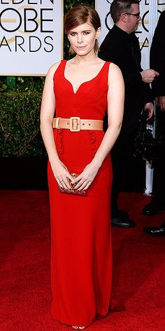11 Must-See Red Dresses From the Red Carpet | KATE MARA | The actress offset her red hair with one of the more controversial looks in the PEOPLE offices: A sweetheart-neckline Miu Miu gown with a nude patent belt.