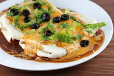 Chicken Wet Burritos-this has a beef gravy and enchilada sauce mixture....interesting