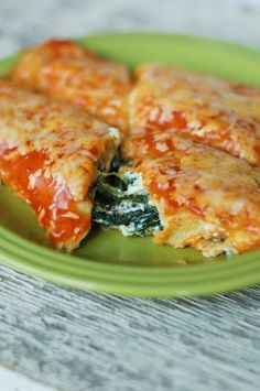 Easy spinach enchiladas recipe - always looking for ways to sneak Spinach onto my kids' plates =)