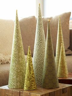 Create a tabletop forest of pretty Christmas trees. Roll patterned papers in shades of green around plastic foam cones; glue into place. Hot-glue sparkling bead atop each tree.