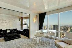 le plus beau appartement atypique, tapis beige, une fenetre grande avec une belle vue