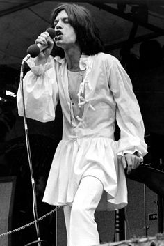 Mick Jagger performs at Hyde Park in 1969, wearing a white dress.