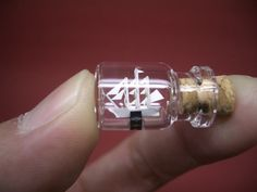 Miniature Sailing Ship is in a tiny bottle -Bottle ship Miniature Bottles, Miniature Crafts, Miniature Dolls, Bottle Charms, Bottle Necklace, Bottle Jewelry, Mini Bottle, Bottle Bottle, Ship In Bottle
