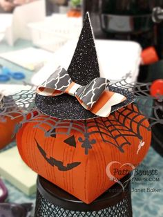Curvy Keepsake pumpkin with black glimmer witches hat.. cutest Halloween treat ever! Stampin UP! spider web doily is the perfect accent!