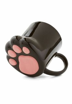 modcloth:  Cat-lovers and coffee-connoisseurs unite with the Pawsitively Bemused Mug,