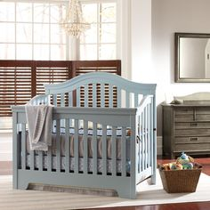 Traditional boy's nursery design. Love the mix of finishes.