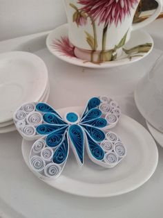 Circul Magic Shop: blue and white quilling butterfly