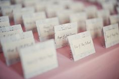 Lace detail escort cards on a pink linen | Photography: Lifetime Media | Wedding Planner: Cosmopolitan Events