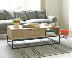 Clap Trap coffee table has a handy lift-up top and shelf for extra storage. It is hand carved from reclaimed fir with a beautiful beached timber finish.