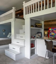 Shared boys bedroom for 3 boasts a white built-in loft bed fitted with two beds and a white staircase finished with storage drawers.