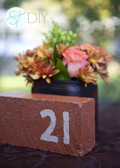 Hand painted brick as wedding table numbers, so cute and SO easy!