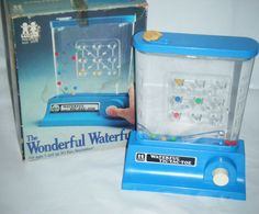 I remember playing this handheld water game!  #Vintage 1976 Tomy Wonderful Waterfuls Tic-Tac-Toe Game with Original Box #7012 #Tomy #retro #fabulous