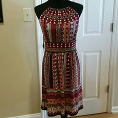 Maggie London Sundress Cool and breezy polyester spandex Maggy London sundress! You will love this cute Aztec print! This dress has a fitted waist and a lined top easy to wear braless. EUC worn once Maggy London Dresses