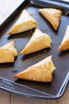 Tiropita: Greek-style hand pies which are light, crispy and filled with feta cheese! Great as party appetizers or served with a light summer salad