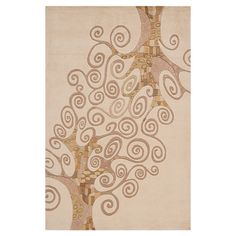 Hand-tufted wool rug with swirling tree motif.   Product: RugConstruction Material: 100% WoolColor: Iv...
