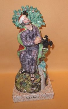 """STAFFORDSHIRE PEARLWARE FIGURE ELIJAH & THE RAVENS C1820  