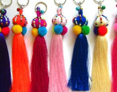 Bling Tassel Keychain Layered Tassel Keyring Jazzy Tassel Key Holder Tassel Colorful Purse Charm Wholesale Tassels Gift for Her Our new design of Bling Bling tassel keychains in assorted tassels which have been handcrafted in coordinated colors. Keychain, Keyring, Zipper Pull, Bag Charm, Unique Gift Ideas, Birthday/Christmas Gift ideas Add to your favorite purse / handbag to add a pop of color Length approx 8 Tiny glass seed bead detail complete with brass clasp. 20 Assorted colors as…