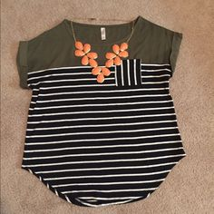 Very chic military green top with striped bottom This top is super chic!! It is a great fabric and very flowy, not super fitted at all. The top is a deep military green with a striped bottom. Very cute! Xhilaration Tops