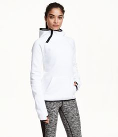 Sports top in thick, fast-drying functional fabric with a hood, zip at side of neck, kangaroo pocket at front, and long sleeves with thumbholes at cuffs. | H&M Sport