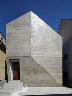A doorway is the only opening in the faceted concrete facade of this family residence in & Gallery of Shirokane House / MDS - 6   Entrance Entrance doors ... Pezcame.Com