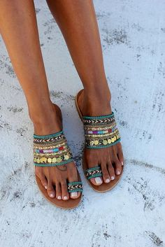 Genie sandals handcrafted in Greece. Handmade Greek sandals made of genuine leather, embellished with colorful ethnic trims and gold plated charms. Inspired by the Arab tradition, the well-known mythical spirits Genies and the stories around them, we created this design. Wear the #sandalssummer