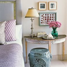 This inviting Laguna Beach guest room gets beachy flair from a pretty, white shell atop a mirrored antique. Its size and interesting shape work well with the table vignette.