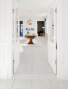 Really wide plank bleached white wood floors in a dining room!  Very nordic. :-) http://cococozy.com