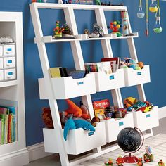 Furniture occasionally needs somebody to lean on, too.  In the case of The Land of Nod's Little Sloane Leaning Bookcase, all it needs is a wall.  They've taken the unique leaning design of Crate and Barrel's Sloane furniture collection and scaled it down to accommodate your little ones.  They save space by taking up less area on the floor, and they secure to the wall for added safety.