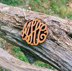 Get in touch with nature with our Cherry Wood Carved Monogram Necklace.