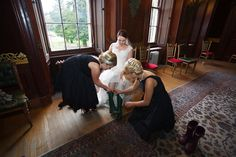 Our beautiful bride Rebecca getting into good Scottish footwear for her Autumn wedding in a Scottish Castle.   Blue Thistle Weddings.