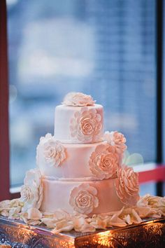 simple white wedding cake with sugar flowers // ultimate sky box wedding in san diego
