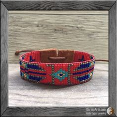 A mix of vintage matte glass seed beads with leather piping + suede ends give this BoHo tapestry bracelet a Southwest vibe. Add one of our Tibetan silver charms to make it your own. Beautifully handcrafted, this piece features shades of red, blue, turquoise, antique silver + gold. Seed Bead Wrap Cuff: KILIM Collection