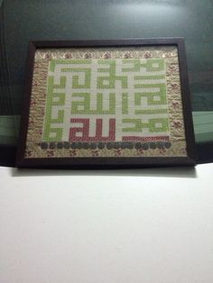 Quran cross stitched