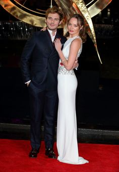 Sam Claflin and his wife, Laura Haddock, at the premiere of The Hunger Games: Catching Fire in London.