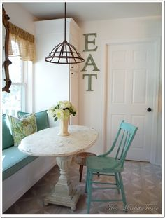 """I haven't seen a green-painted wooden kitchen chair that I do not love. (But please remove the helpful """"EAT"""" instruction from the wall.)"""