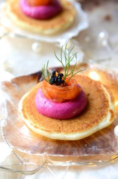 Buckwheat blinis with beetroot and feta pate, smoked salmon ribbons and 'caviart'