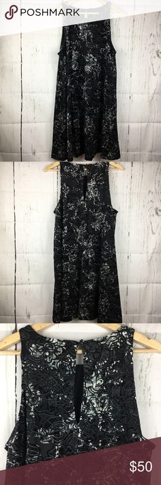 Adrienne Vittadini Velvet Floral Black Dress Sz XL This dress is new with tags! This dress is absolutely beautiful with a black velvet floral pattern. It's sleeveless with a keyhole opening on the back with 1 button closure. Absolutely stunning!  Armpit to armpit- 22 in Armpit to bottom- 27 in  Check out my other listings! Sorry no trades or paypal but offers are welcome!  Item- 154 M1000022617 Adrienne Vittadini Dresses Midi