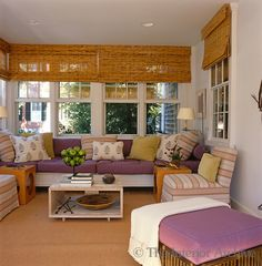 Tom Scheerer ~ The sun room is a mixture of colour and pattern with built-in window seating and bamboo blinds