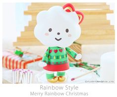 Here comes the season of joy and peace, happiness is all around us. Shining in golden ribbon and colours of Christmas Holly, Miss Rainbow is dressi. Christmas Material, Rainbow Fashion, Designer Toys, Heart Patterns, Hello Kitty, Merry, Joy, Colours, Seasons