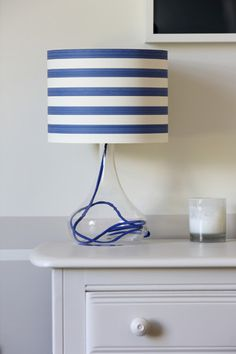 DIY Projects Using Wallpaper: Save money and freshen up a room by covering an old lampshade with a graphic patterned wallpaper like this blue and white nautical inspired stripe. Nautical Lamps, Nautical Bedroom, Nautical Home, Diy Luminaire, Diy Wallpaper, Wallpaper Paste, Striped Wallpaper, Diy Inspiration, Inspirational Wallpapers