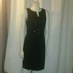 Black career dress size 8 Knee length dress with a silvertone metal circle at the waist and back zipper AGB Dresses