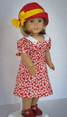 Dress and Cloche for Kit Ruthie or any AG by AnnasGirls. Anna made this in cotton using and slightly modifying a Doll House Designs pattern featuring a gathered bodice attached to a shaped waistline that ties in back with self fabric ties. At my request, this dress closes in back with working yellow buttons and buttonholes. The white collar features yellow topstitching and little yellow buttons at the points.