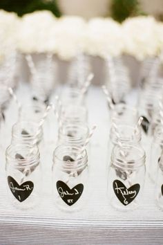Ball Jar Glasses... chalkboard painted heart, write name and table number.  Also the gift... now THAT's efficient and cute.