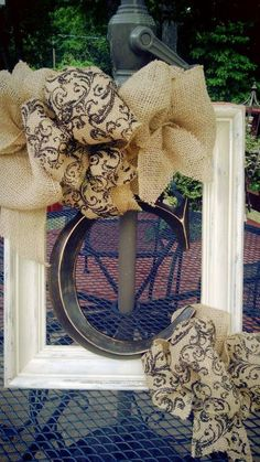 Letter, frame, chicken wire and burlap ribbon (bows a little obnoxious, but otherwise, love it)