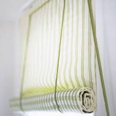 DIY roll up shade. Want to do something like this on our back porch after we finish reno on it.