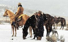 These Ovid, Idaho, cowboys and their trusty cow dog just finished moving a neighbor's cattle in 10-below-zero weather. Photo by Jim Parker. country-magazine.com