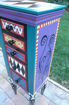 Jewelry armoire!  Alice in Wonderland on a jewelry Box! Love the spirals.