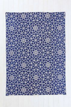 Love the pattern!  Reminds me of Asian tea sets.  (Magical Thinking Star Tile Handmade Rug at Urban Outfitters)