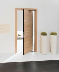 There are basically two types of barn door hardware. The first is a rustic, flat track sliding door system The second is a more modern roller and track style Pivot Doors, Internal Doors, Sliding Doors, Door Design Interior, Interior Barn Doors, Interior Paint, Modern Interior, Porte Design, Cheap Rustic Decor